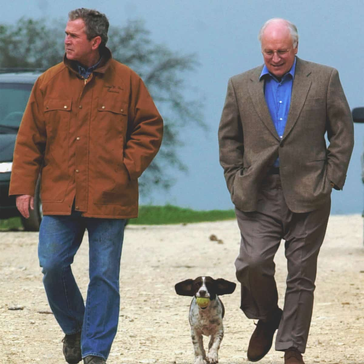 FILE- This Nov. 11, 2000 file photo shows then-Republican presidential candidate Texas Gov. George W. Bush and running mate Dick Cheney walk down a dirt road to meet with reporters, followed by Bush's dog Spot, near Crawford, Texas. (AP Photo/Eric Draper, File)
