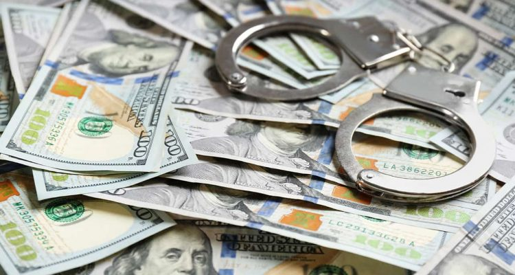 Photo of handcuffs and $100 bills signifying reward money for catching escapes inmates