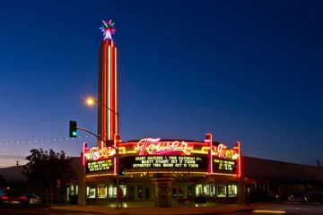 Photo of the Tower Theater and its neon tower at night's